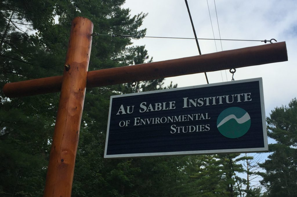 A picture of the sign for the Au Sable Institute just outside the Institute in Mancelona, Michigan.